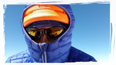 Man in high altitude mountaineering clothing