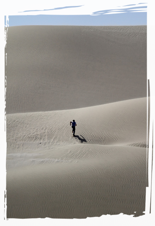 Person running across the desert